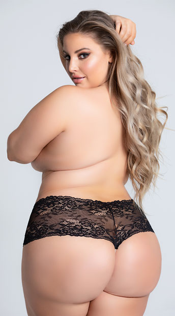 woman in a plus size pearl string short from yandy